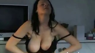 mature brunette strips off and teases with her tits and pussy on webcam